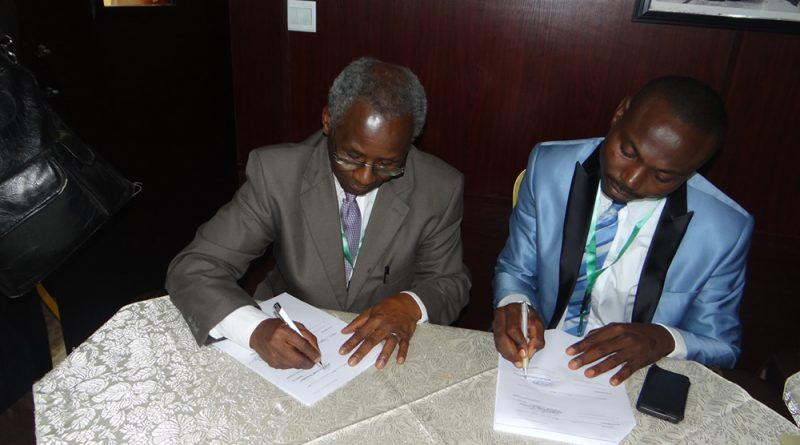 President, NAS signing MoU with President, Nigerian Young Academy