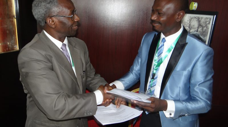 NAS President, shaking hands with President, Nigerian Young Academy after signing MoU